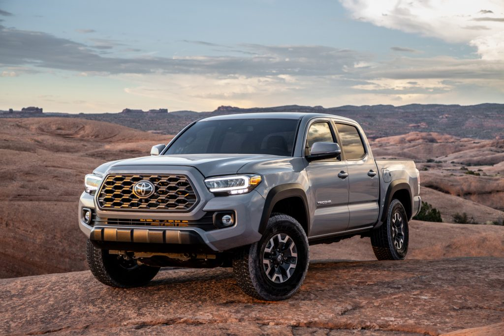 A silver 2020 Toyota Tacoma compact pickup truck parked on display