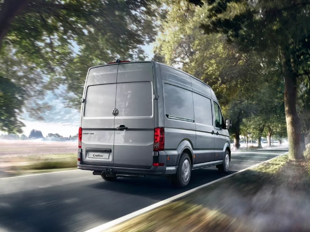 A gray 2020 Volkswagen Crafter drives down the road