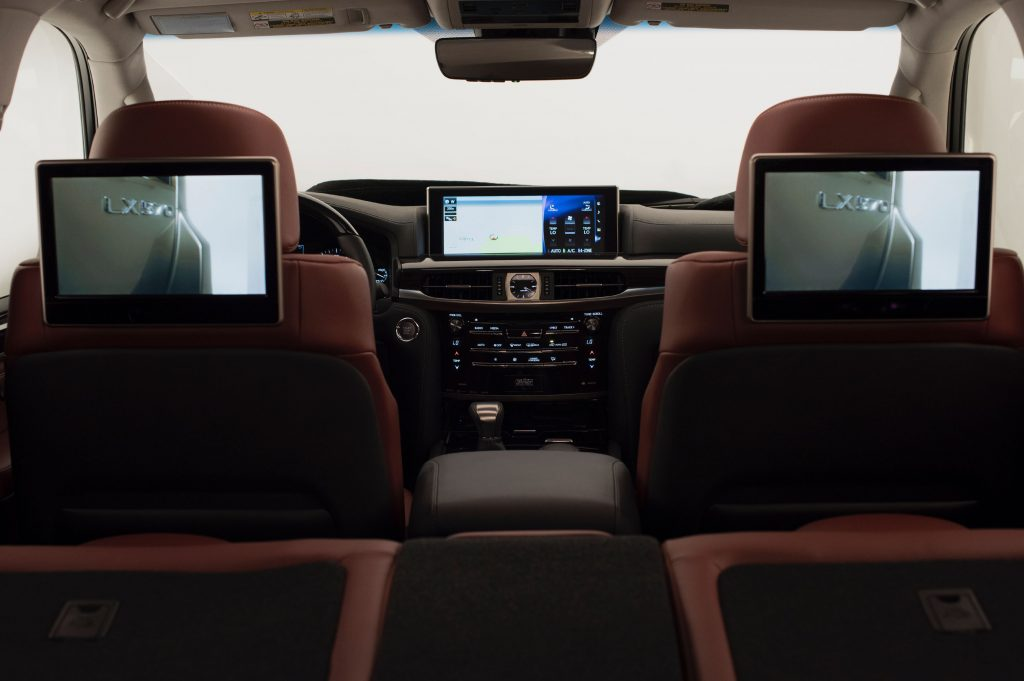 the interior of a Lexus LX 570 family SUV with entertainment screens