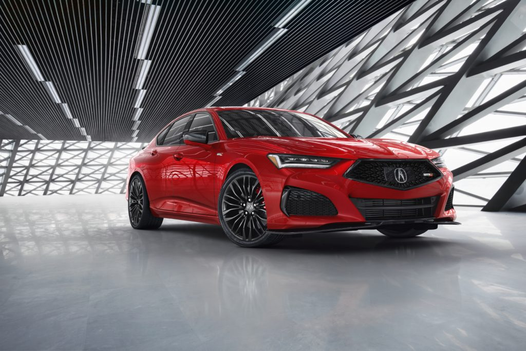 The 2021 Acura TLX Type S on display in front of a futuristic gray and silver background