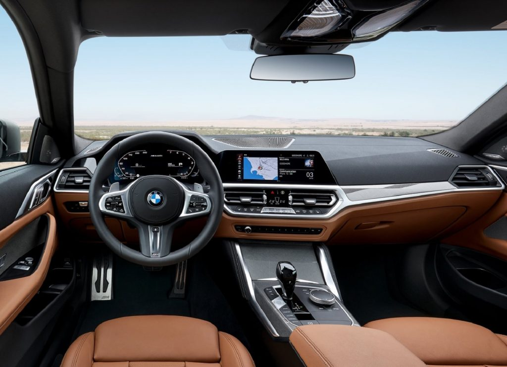 The 2021 BMW M440i xDrive's front seats and dashboard