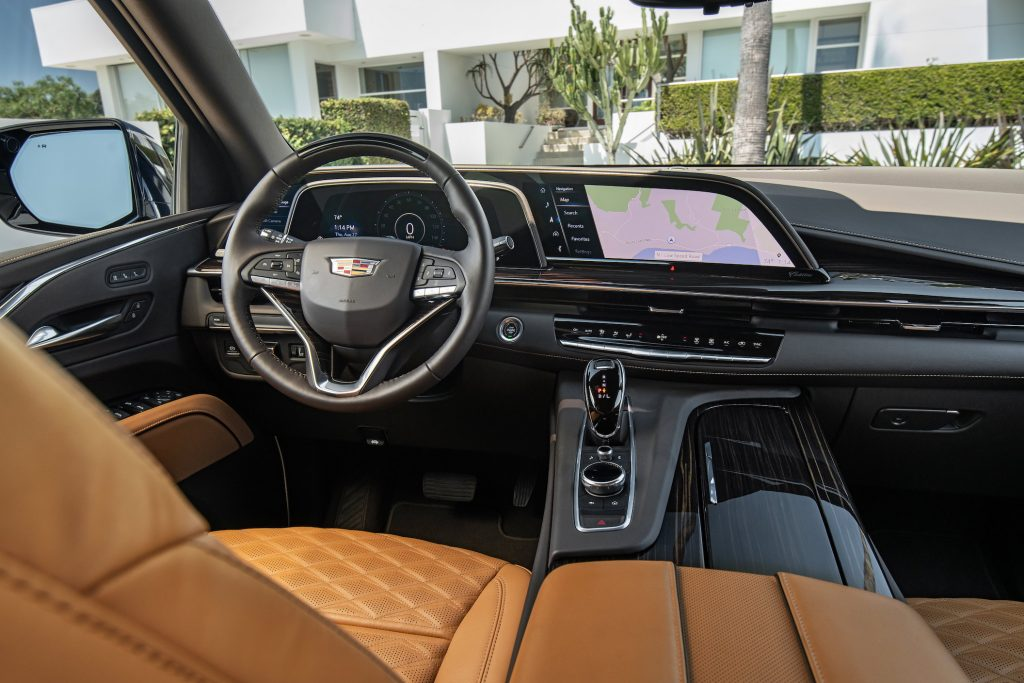 "The new 2021 Cadillac Escalade showcases an industry first 38"" diagonal curved OLED display and available Super Cruise."