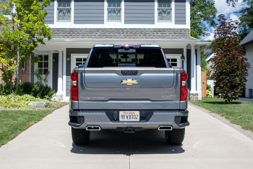 2021 Chevrolet Silverado Multi-Flex Tailgate with the truck parked in front of a house