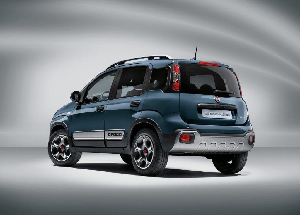 The rear 3/4 view of a blue 2021 Fiat Panda Cross
