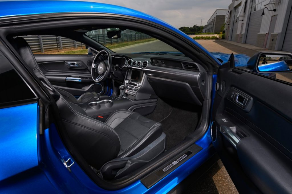 A look into the interior of a blue 2021 Ford Mustang Mach 1 through the view of the passenger door