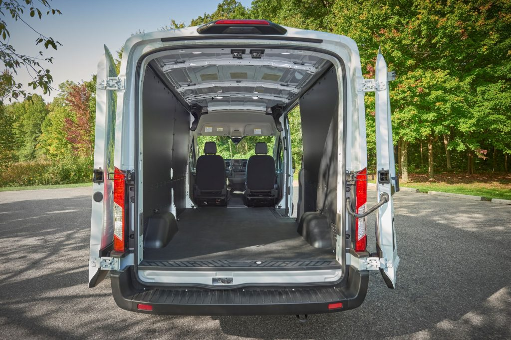 The 2021 Ford Transit's cargo area and interior seen from the open rear doors