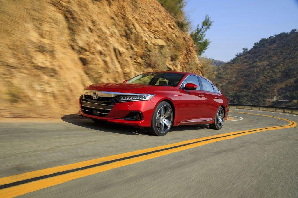 2021 Honda Accord Hybrid driving down a road