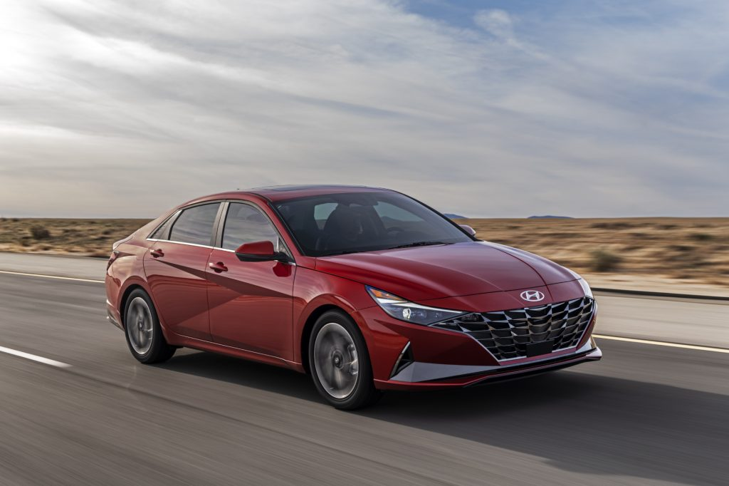 A red 2021 Hyundai Elantra driving on a highway