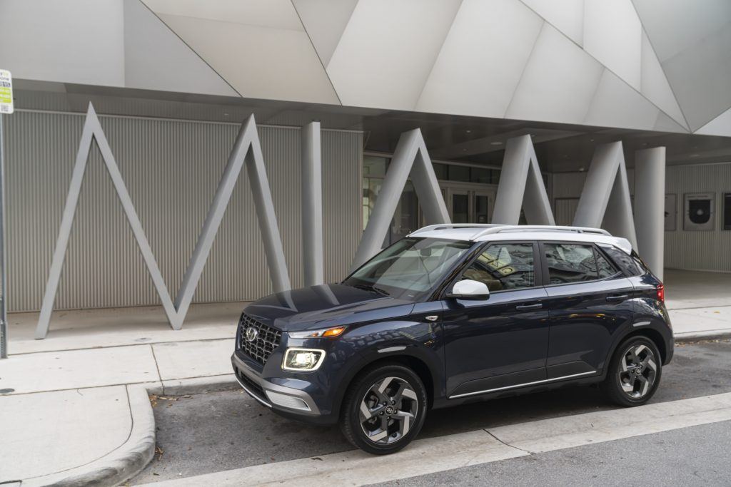 The 2021 Hyundai Venue parked on display in front of a building