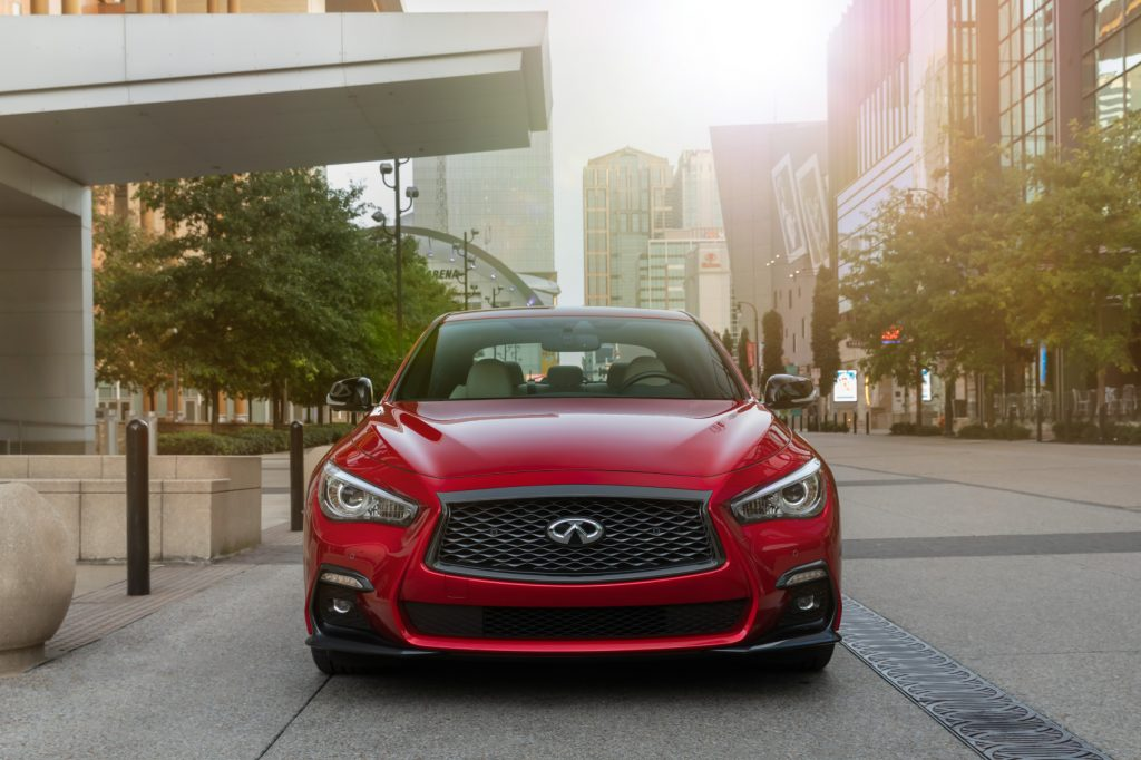 The 2021 Infiniti Q50 facing the camera in the middle of a city