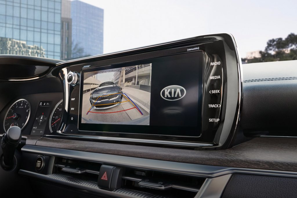 A close-up of the 2021 Kia K5 EX's touchscreen with the rearview camera displayed
