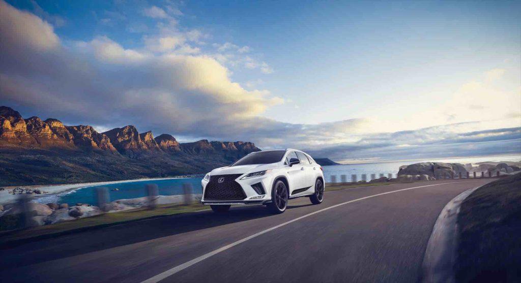 A 2021 Lexus RX with Black Line trim drives down a coastal road