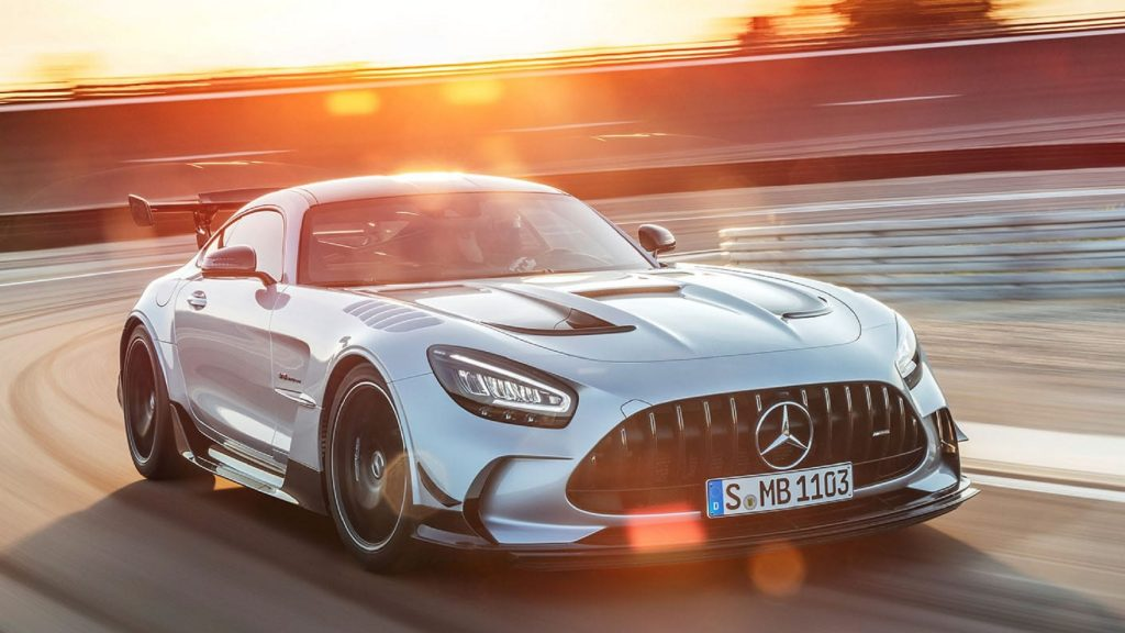 A silver 2021 Mercedes-AMG GT Black Series goes around a racetrack corner