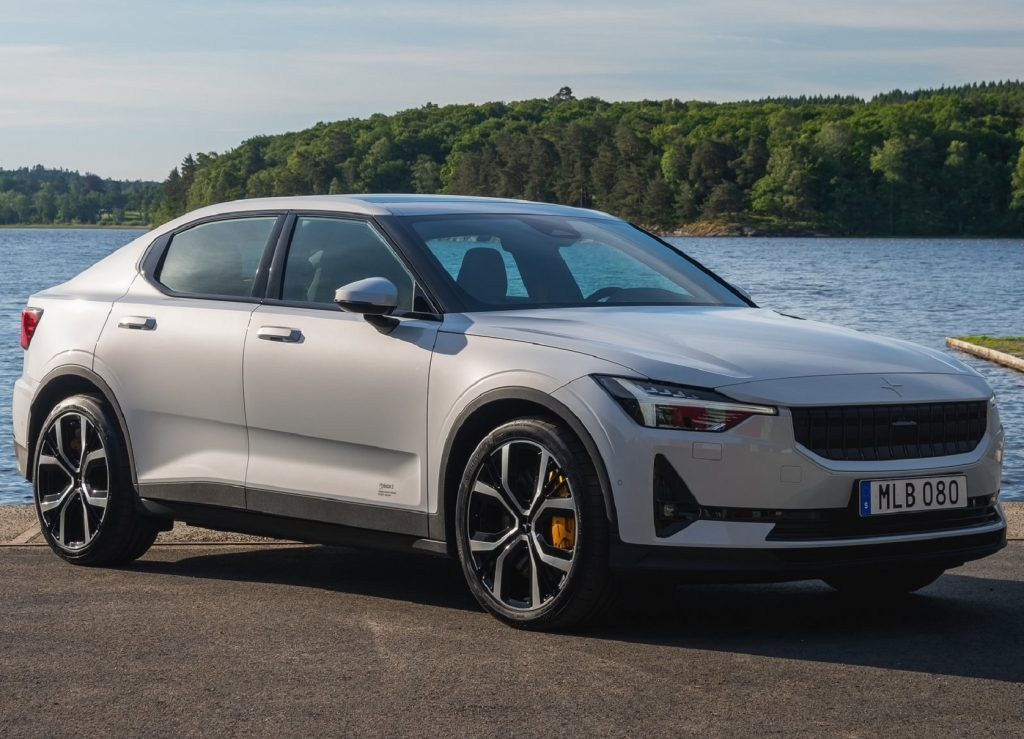 A white 2021 Polestar 2 in front of a body of water