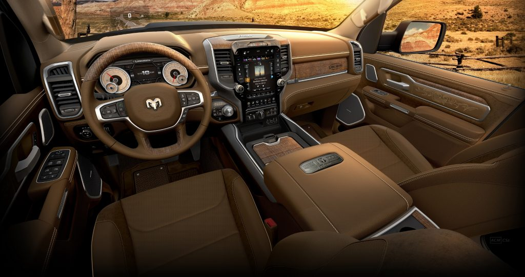 An interior view of the driver and front passenger seats and dashboard of the 2021 Ram 1500 Limited Longhorn 10th Anniversary Edition.