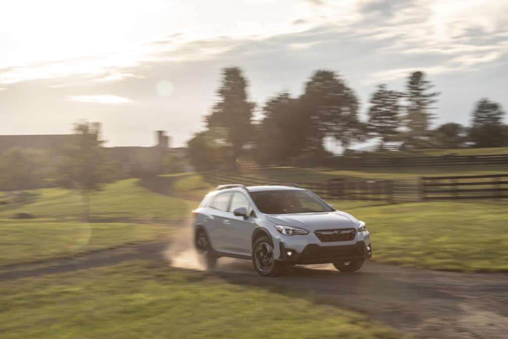 2021 Subaru Crosstrek driving through a field