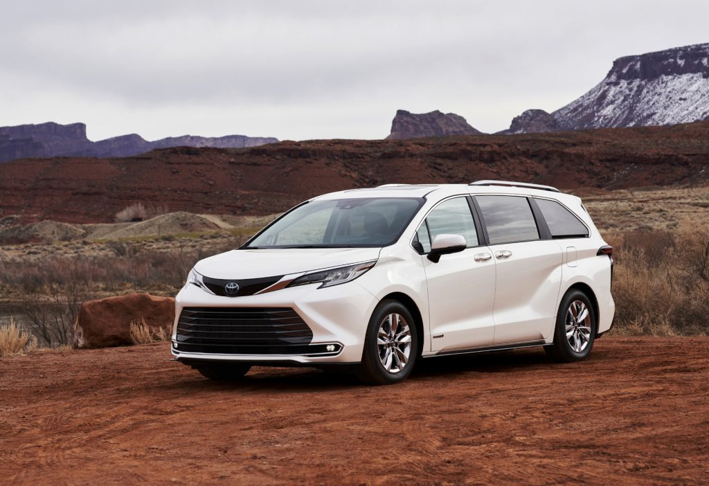 A white 2021 Toyota Sienna on display in a desert terrain