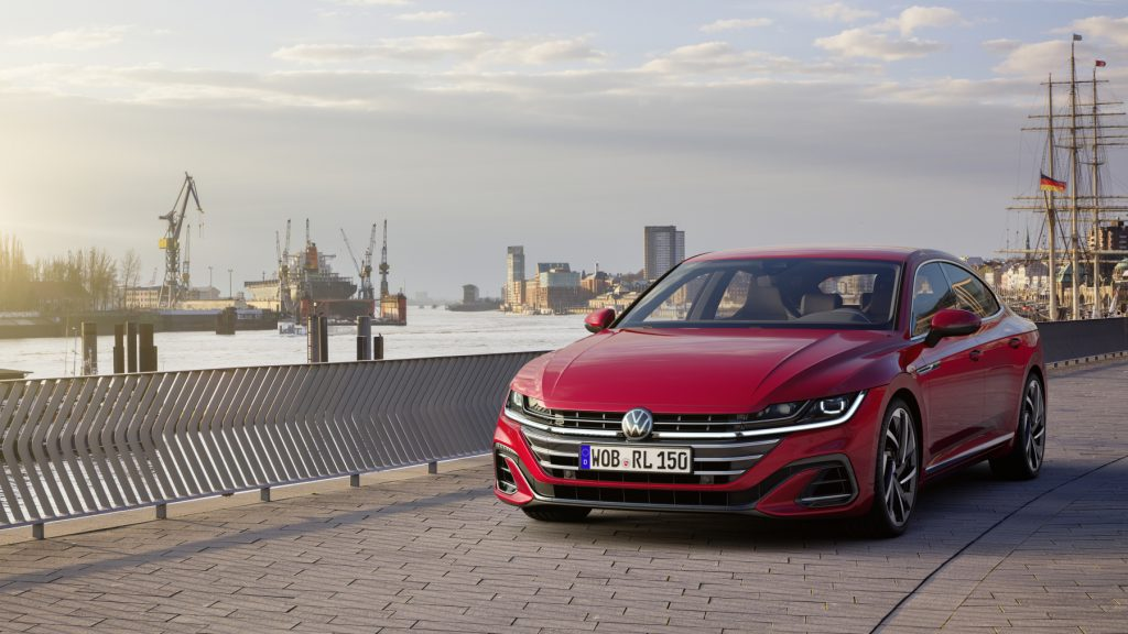 A red 2021 Volkswagen Arteon driving down a street