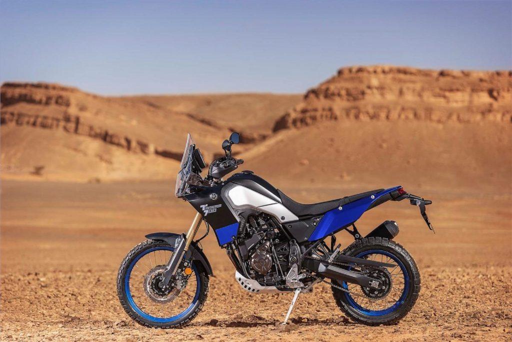 A blue 2021 Yamaha Ténéré 700 by the desert landscape