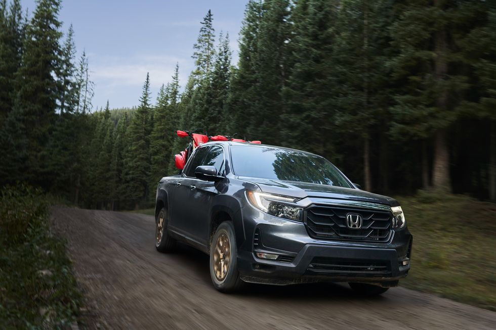 2021 Honda Ridgeline driving on dirt road