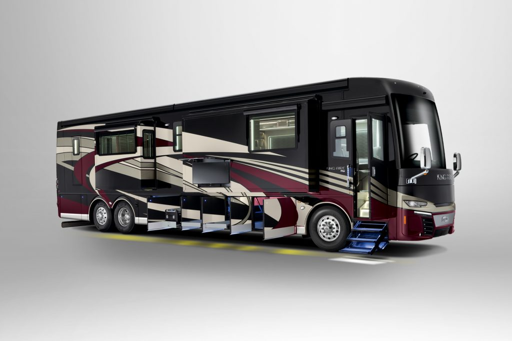 A Newmar Corp King Aire RV has all its storage compartment door open on the bottom of the bus.