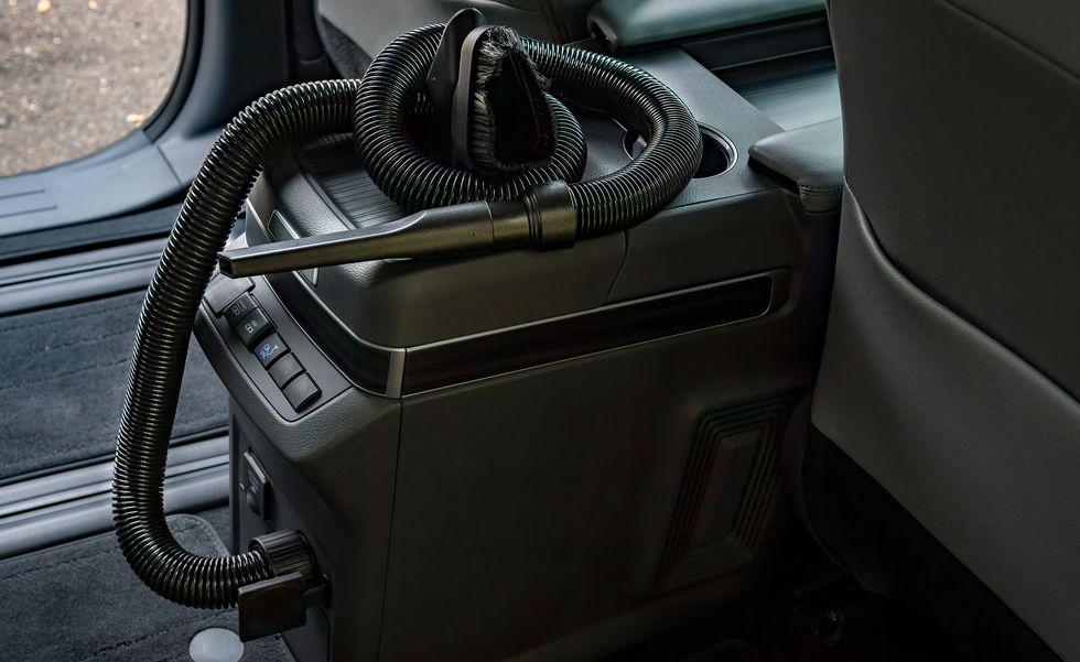 A Sienna van with an in-car vacuum in the console area.