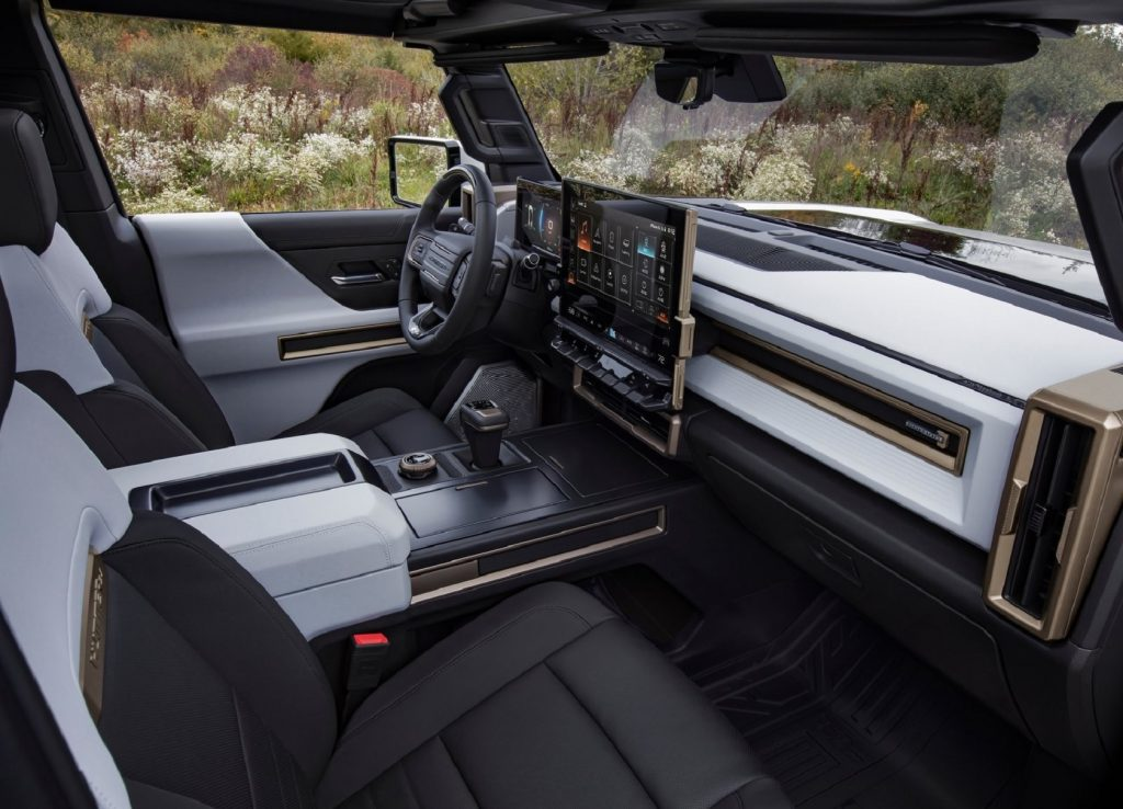 The 2022 GMC Hummer EV Edition 1's front seats, dashboard, and digital screens