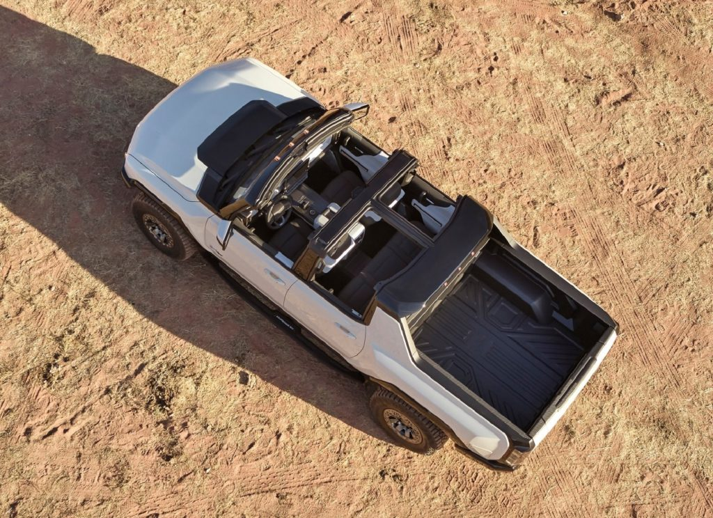 An overhead view of a white 2022 GMC Hummer EV with its roof removed
