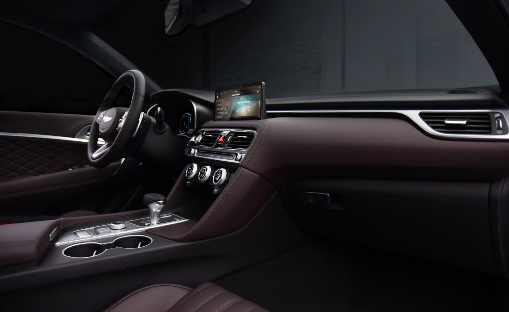 Interior shot of 2022 Genesis G70 sedan showing steering wheel, infotainment screen, and center console