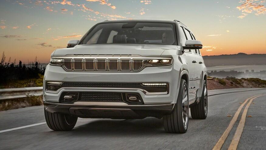 2022 Jeep Grand Wagoneer driving at dusk
