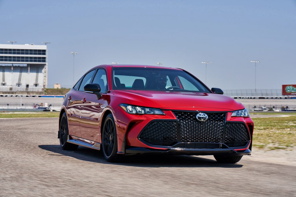 A red 2020 Toyota Avalon on a speed track
