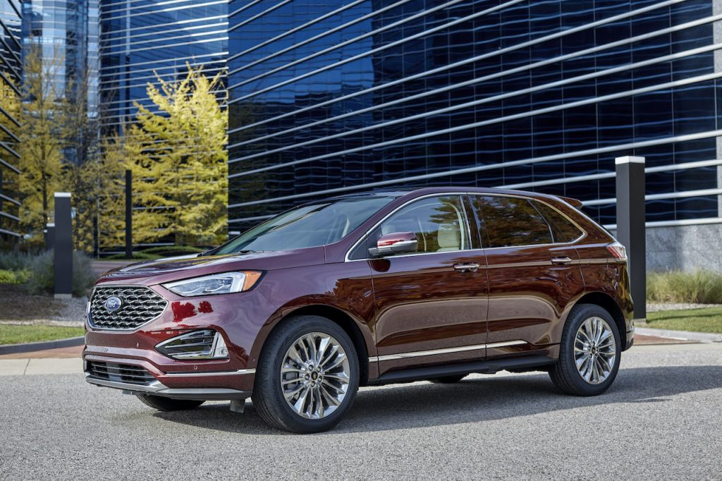 A burgundy 2021 Ford Edge outdoors.