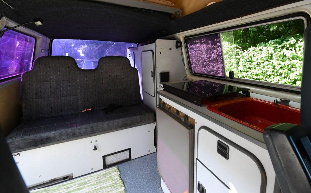 The sink and fridge in a converted Volkswagen T3 camper van