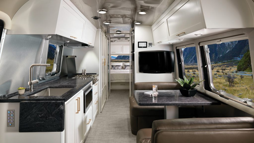 A Airstream Classic with a white cafe latte color kitchen area.