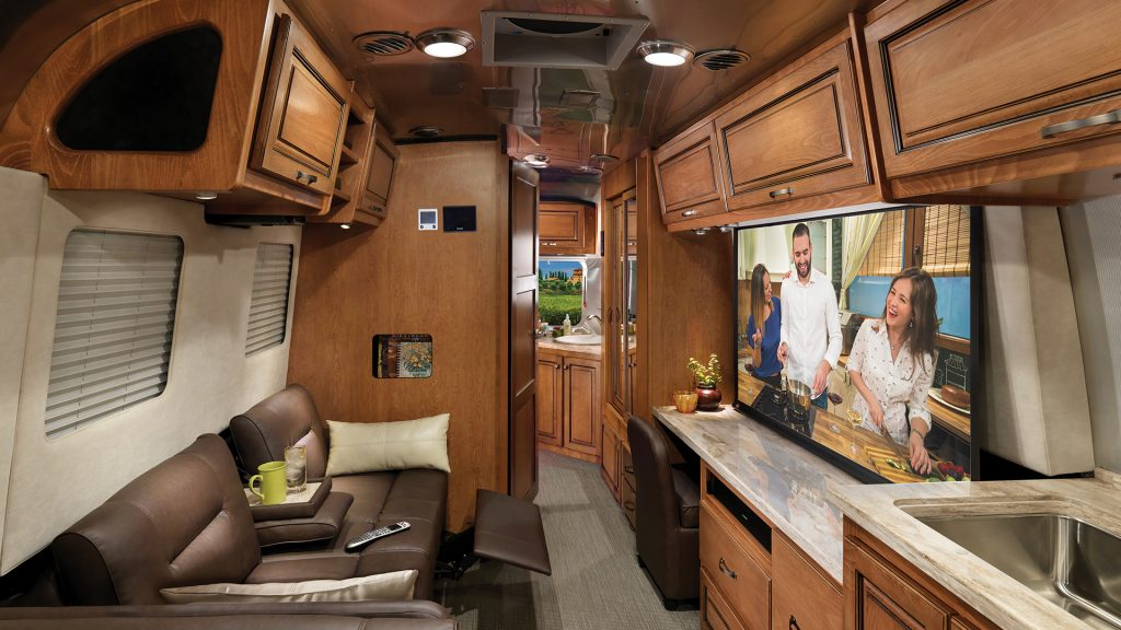 the entertainment space of an Airstream classic with a HDTV