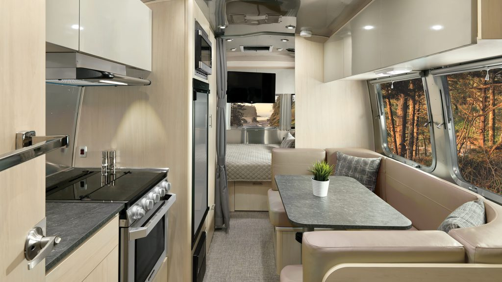 The dining area inside a Flying Cloud travel trailer.