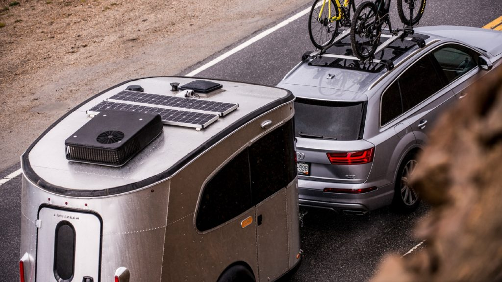 An Audi crossover towing an Airstream Basecamp trailer