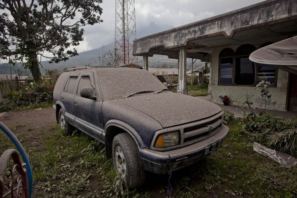 Volcanic ash covers an SUV in Indonesia