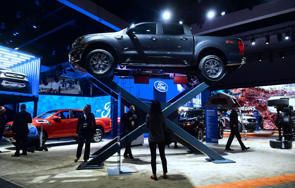 A Ford Ranger on a raised display at an auto show