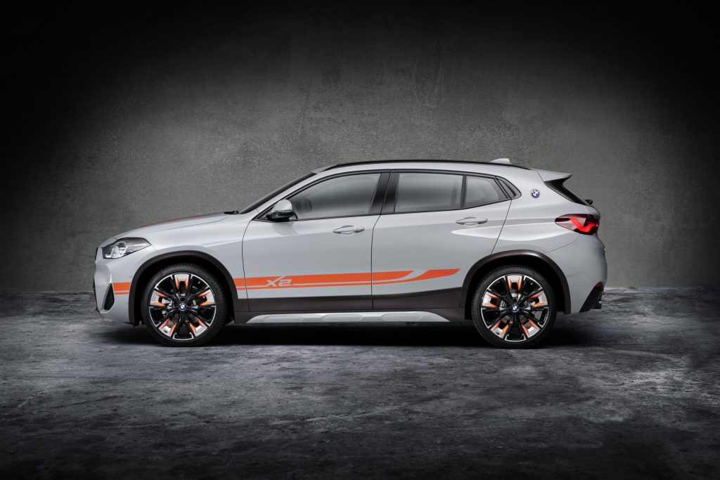 2021 BMW X2 M Mesh Edition on display in front of a gray and black background