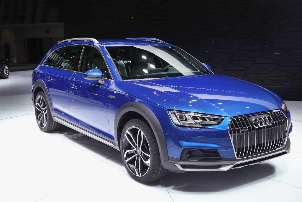 A blue Audi A4 Allroad wagon on display at an auto show