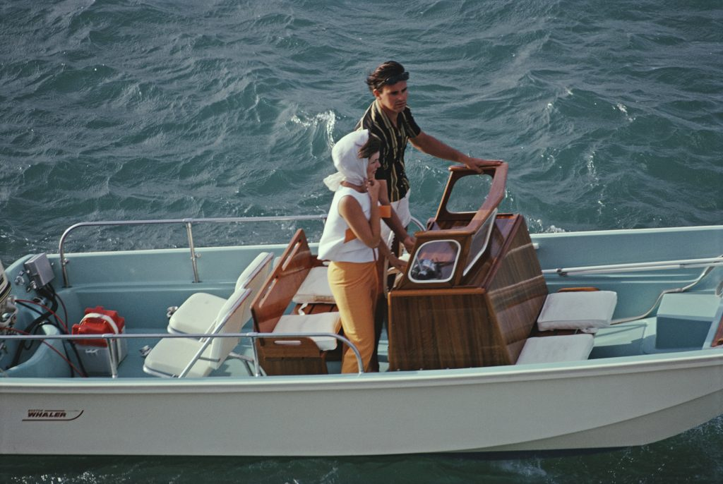A man and woman take their Boston Whaler boat out to sea at Lyford Cay, Bahamas