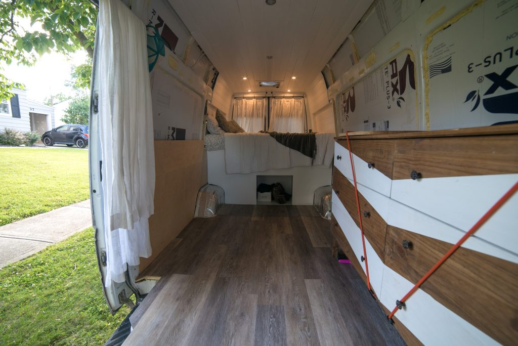 The layout inside of a converted camper van