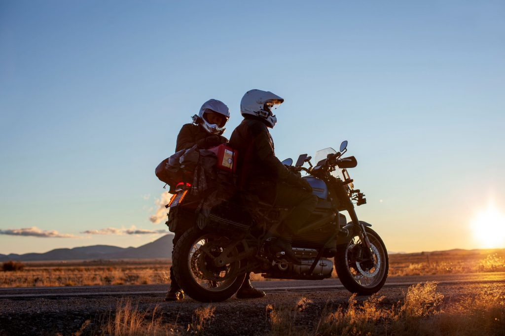 Charley Boorman organizes gear on Ewan McGregor's Harley-Davidson LiveWire
