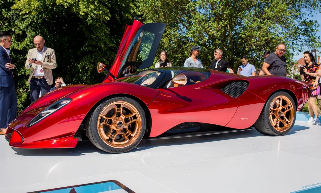 A red De Tomaso P72 sits on display
