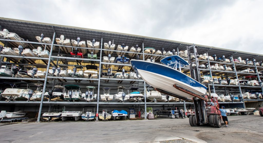 Workers at a drydock are organizing boats