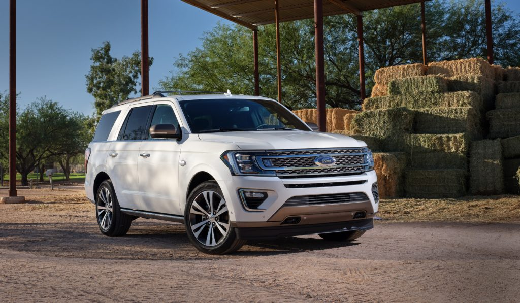 A 2020 Ford Expedition parked in front of a haystack