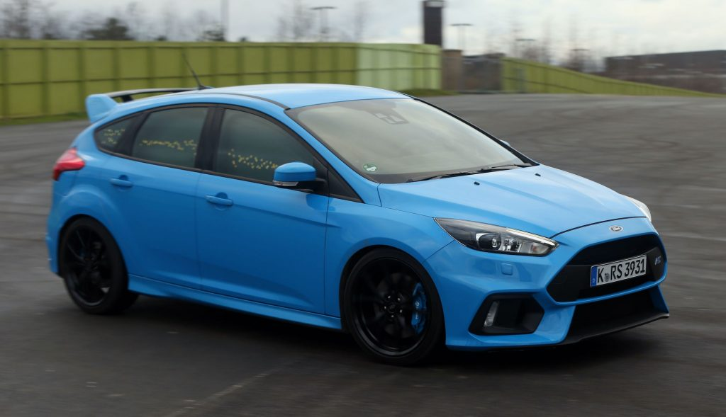 A Ford Focus RS, at Stratford Waterfront in London, displays its 'Buzz Moment' whereby some exterior lights illuminate in tune to the driver's emotions