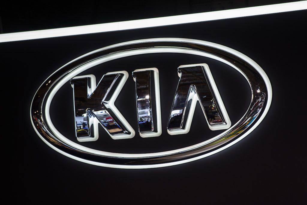 A close up image of the Kia logo.
