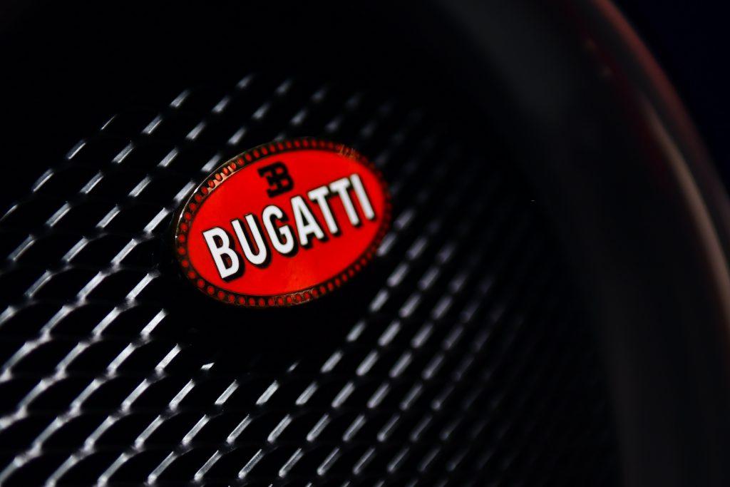 An up-close image of the Bugatti logo.